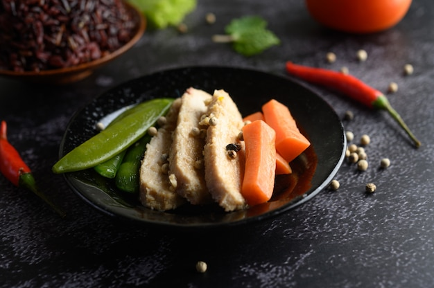 Purple rice berries cooked with grilled chicken breast. pumpkin, carrots, and mint leaves in a dish, clean food.
