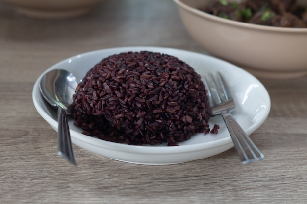 Purple  rice cooked on white dish ready for serve