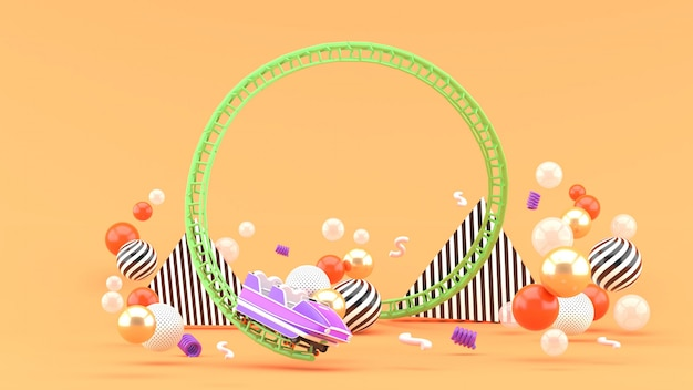 A purple roller coaster among colorful balls onn orange. 3d rendering.
