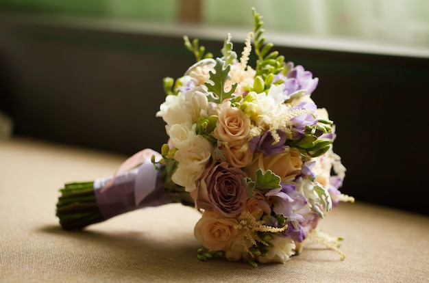 Purple rose bouquet for the bride on her wedding day