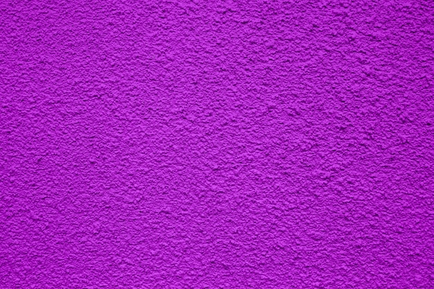 A purple rough background or texture for use in construction or banners