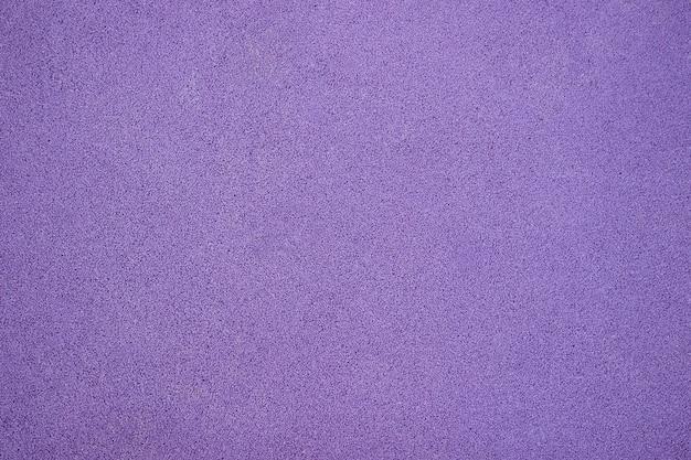 Фиолетовое резиновое покрытие текстуры игровой площадки