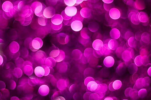 Purple shiny glitter holiday beautiful abstract blur bokeh background.