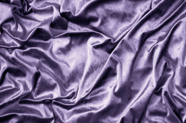 紫の光沢のあるシルクの生地の質感