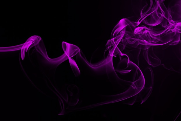 Purple smoke abstract on black background and darkness concept