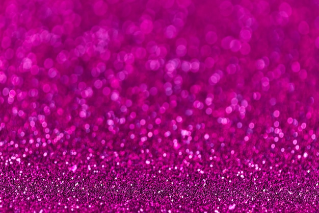 Purple sparkling background from small sequins, closeup