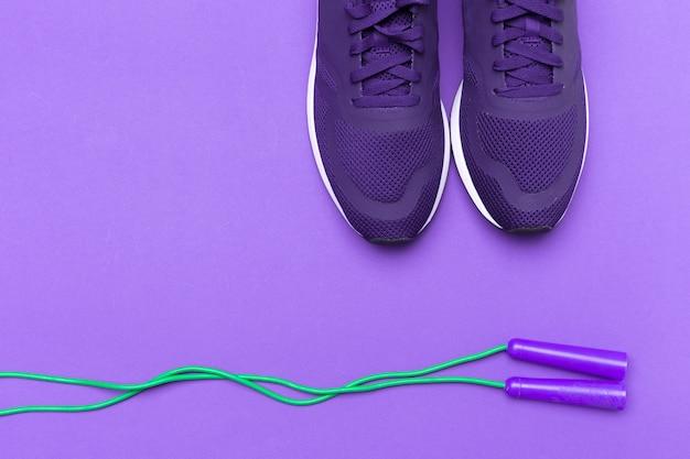 Purple sportive sneakers on purple background