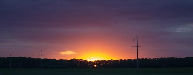 Purple sunset over power lines