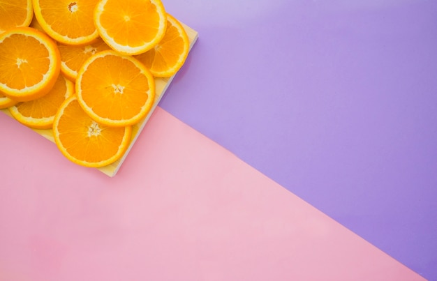Purple surface with tasty orange slices