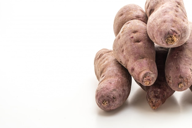 Purple sweet potato on white background