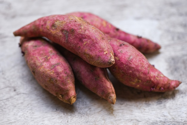 Purple sweet potato on wooden table, yam purple