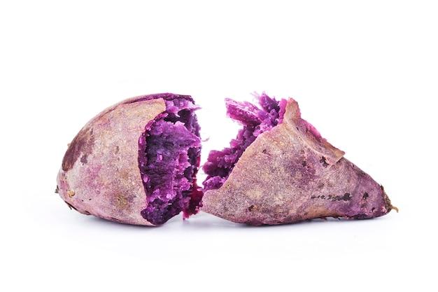 Purple sweet potatoes on white