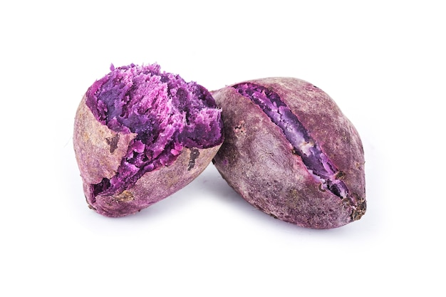 Purple sweet potatoes on white