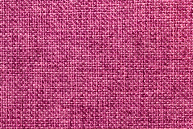 Purple textile background closeup. structure of the fabric macro