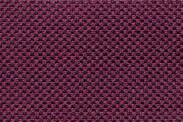 Purple textile background with checkered pattern,  structure of the fabric