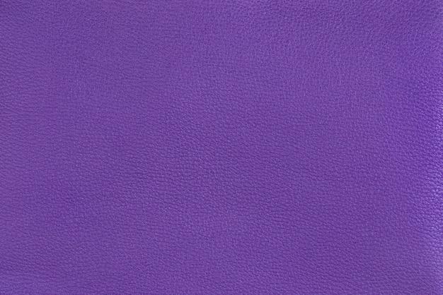 紫の質感の滑らかな革の表面の背景、小さな木目