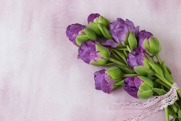 Purple tulips tied with a lace ribbon