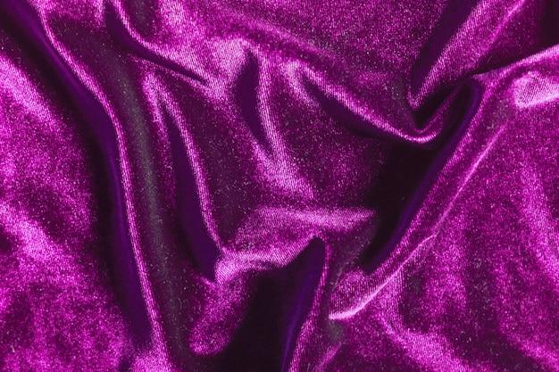 Purple velvet folds texture background