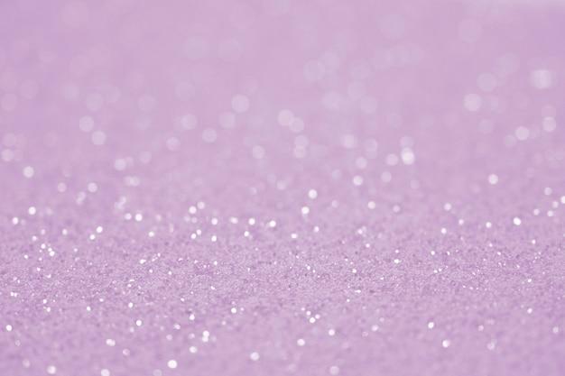 紫のヴィンテージキラキラデフォーカスぼやけたテクスチャクリスマス抽象的な背景。