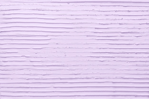 紫の壁のペンキの織り目加工の背景