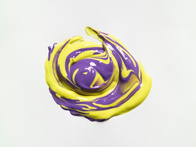 Purple and yellow paint on white canvas