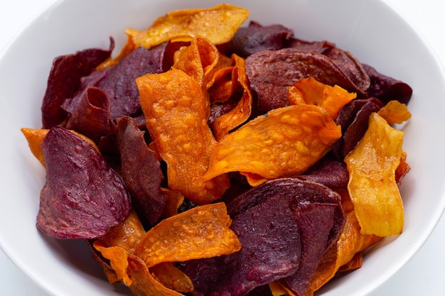Purple and yellow sweet potato chips in bowl