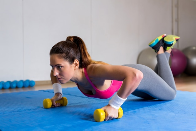 Push-ups with dumbbells