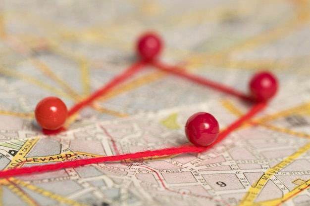Pushpins with thread on route map high view