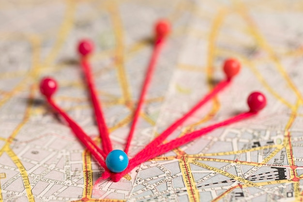 Pushpins with thread for route vintage map