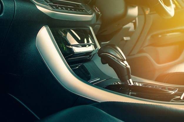 Put a gear stick into p position (parking) and gear position symbol on automatic transmission in a luxury car.