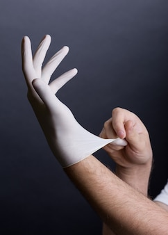Putting on latex gloves