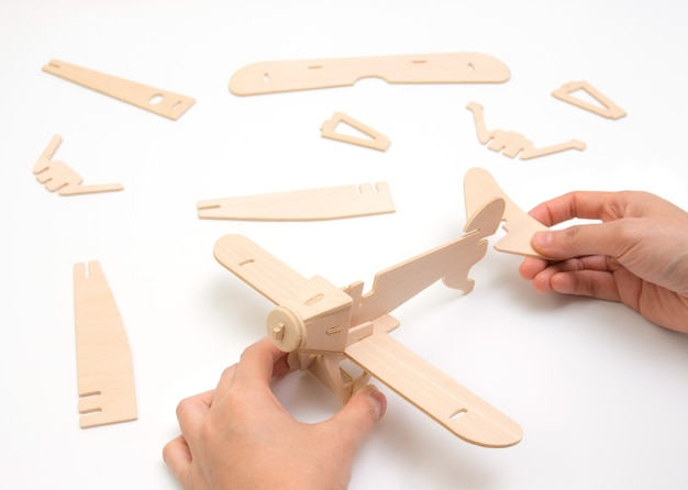 Puzzle airplane piece, construction and development