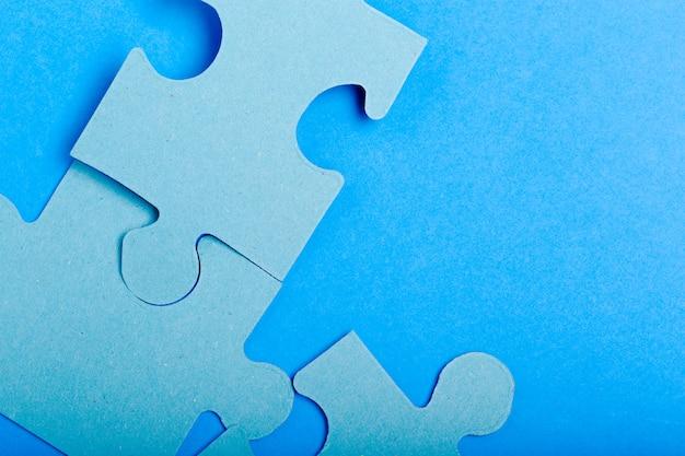 Puzzle concept, blue background