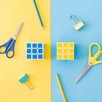 Puzzle cubes and office tools laying in combination