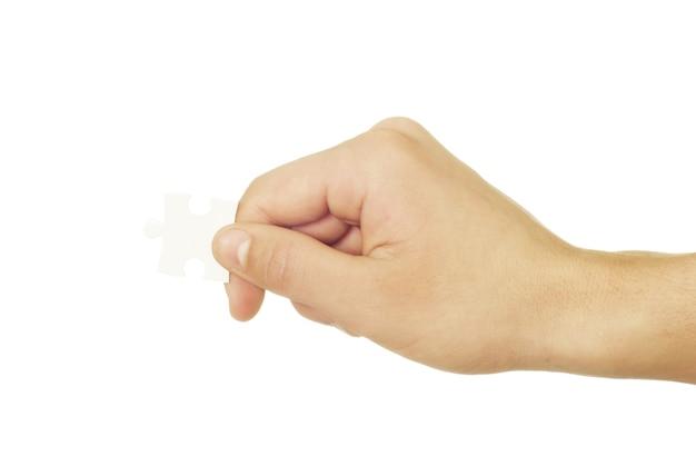 흰색 배경에 고립 된 손에 퍼즐