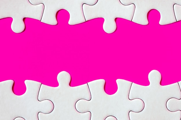 Puzzle pieces on fuchsia background
