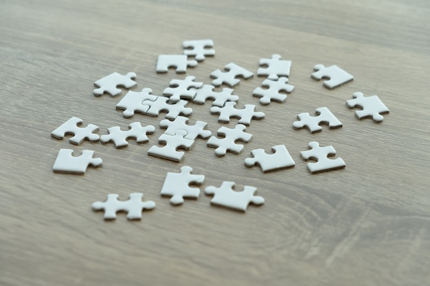 Puzzle pieces on the wood table
