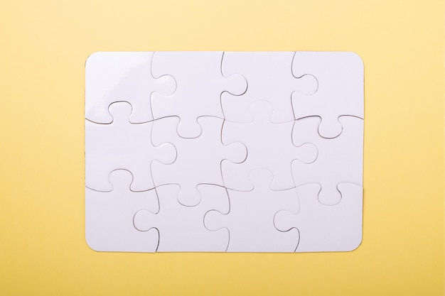 Puzzle pieces on yellow