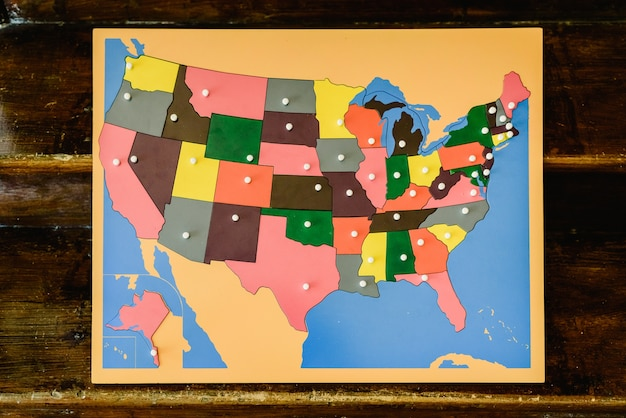 Puzzle with map of the states of the united states of america in a montessori classroom.