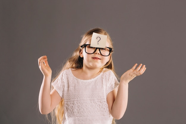 Puzzled girl in glasses