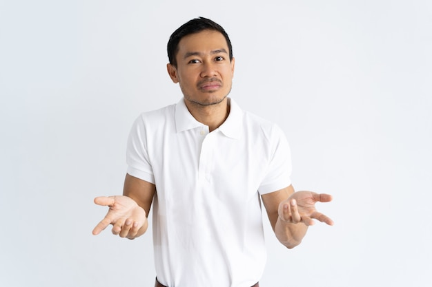 Puzzled guy shrugging shoulders