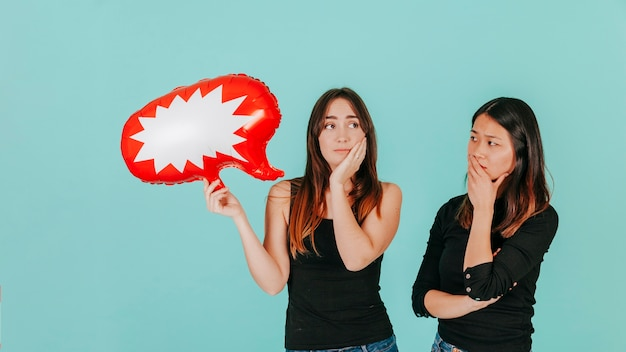 Puzzled women with speech bubble