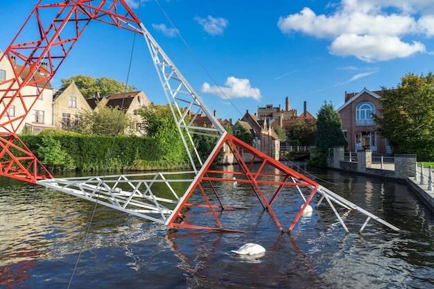Pylon in the canal in bruges