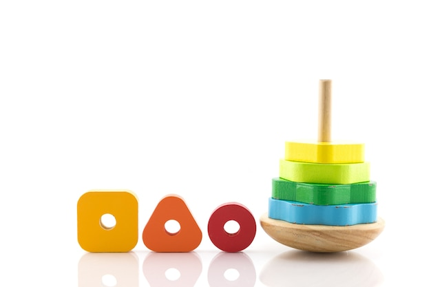 Pyramid build from colored wooden rings toy for babies and toddlers to joyfully learn mechanical