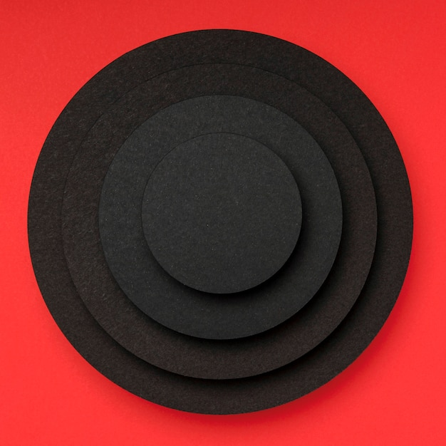 Pyramid of circular pieces of black paper