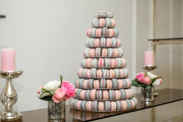 Pyramid of colorful macaroons, sweets on the holiday, edible decoration,