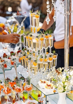 Pyramid of glasses of champagne. wedding table decoration. celebration and party. catering concept.