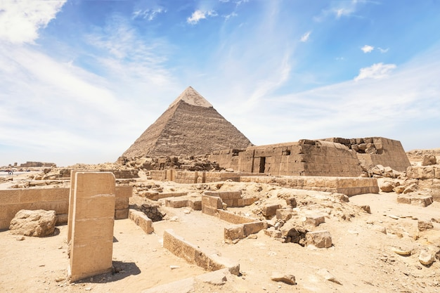 The pyramid of khafre , pyramid of chephren, at giza with the egyptian temple. ancient ruins of the temple in front of the pyramid