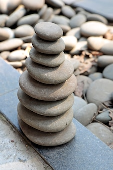 Pyramid of large gray pebbles.