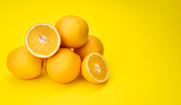 Pyramid of lemons with yellow background